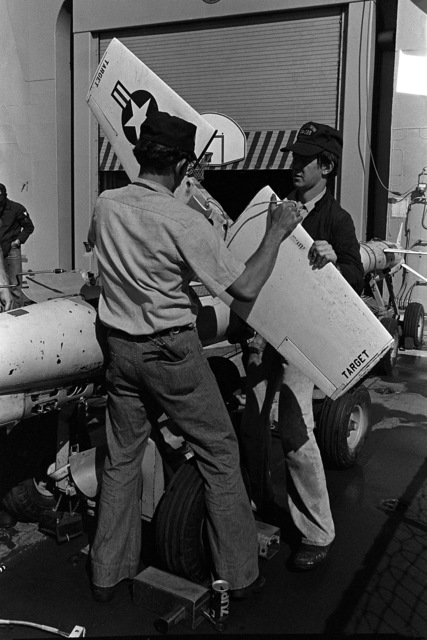 Crewmen prepare to place the wing onto the body of a drone before its launching from the deck of the frigate USS JESSE L. BROWN (FF-1089) during exercise Unitas XX
