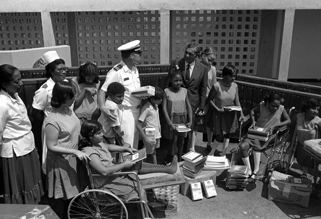 LT. CMDR. L. E. Markham, exercise Unitas XX chaplain, visits with residents of the Princess Elizabeth Center for Handicapped Children