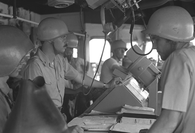 Officers and crewmen stand watch in the pilot house of the guided missile destroyer USS DEWEY (DDG-45) during exercise Unitas XX