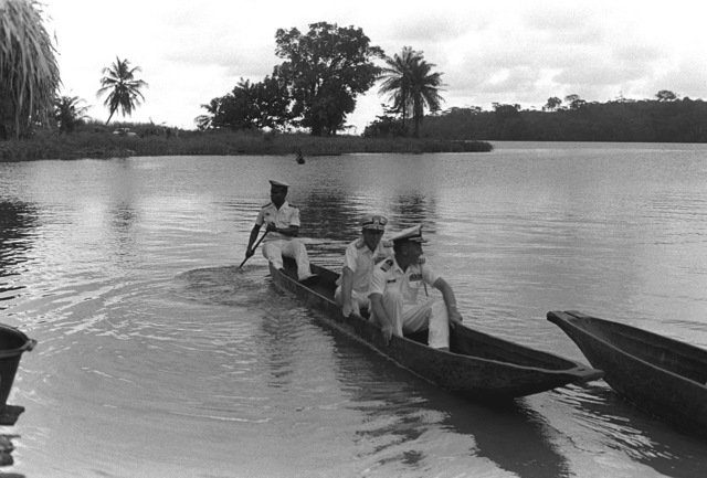 RADM John Ekelund, Unitas XX commander, and other officers participating in exercise Unitas XX arrive at Tiagba village in a small boat