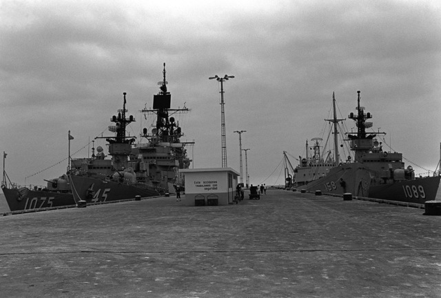 The Unitas XX task force in port, along with a replenishment ship. From left to right are the frigate USS TRIPPE (FF-1075) and the frigate USS JESSE L. BROWN (FF-1089)