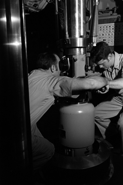 Two crewmen aboard the attack submarine USS BONEFISH (SS-582) operate the periscope during exercise Unitas XX