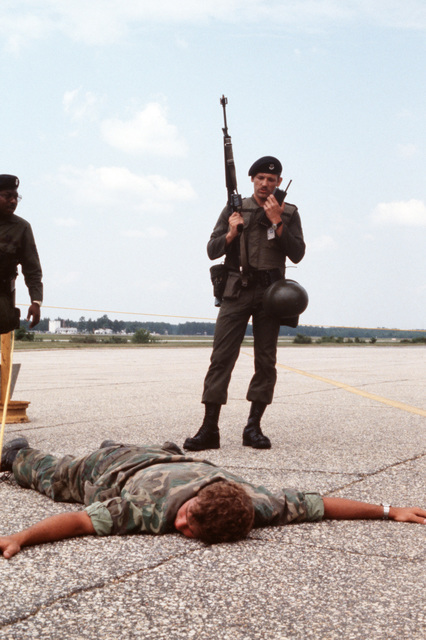 A member of the 62nd Military Airlift Wing radios for assistance after apprehending a suspected saboteur during a security police tactical evaluation conducted as part of Exercise VOLANT RODEO '79