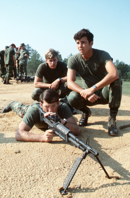 Combat control team members of the 437th Military Airlift Wing practice firing an M60 machine gun prior to the target competition during Exercise VOLANT RODEO '79