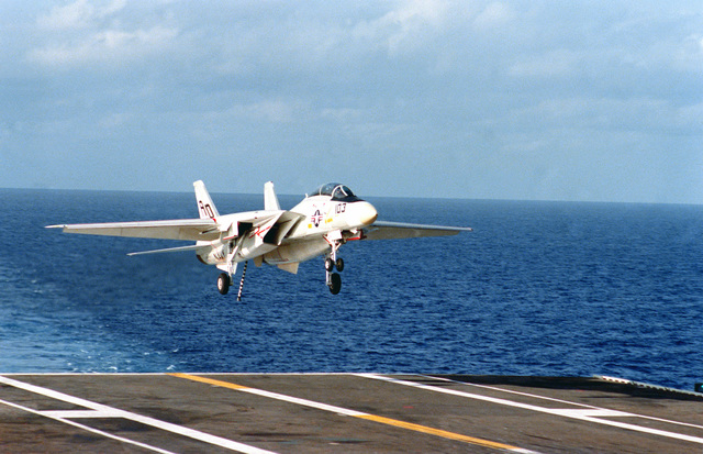 A right front view of an F-14 Tomcat as it prepares to land on the flight deck of the aircraft carrier USS INDEPENDENCE (CV-62)