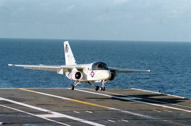 A right front view of an S-3 Viking aircraft landing on the flight deck of the aircraft carrier USS INDEPENDENCE (CV-62)