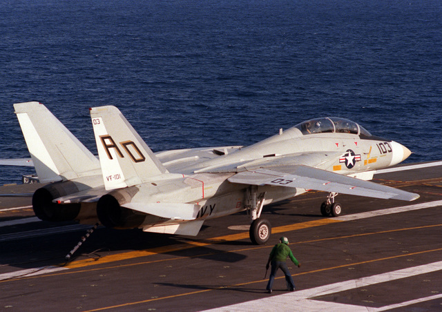 A right rear view of an F-14 Tomcat from Fighter Squadron 101 (VF-101) completing a successful recovery aboard the aircraft carrier USS INDEPENDENCE (CV-62)