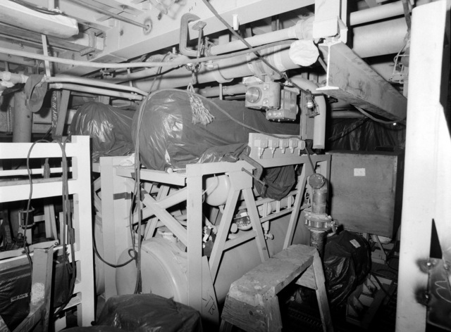 A interior view of auxiliary machine room No. 2 on the guided missile frigate USS ESTOCIN (FFG 15) under construction