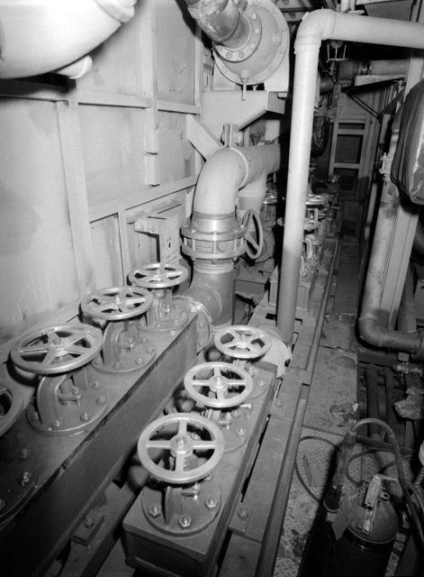 An interior view of auxiliary machine room No. 1 on the guided missile frigate USS ESTOCIN (FFG 15) under construction