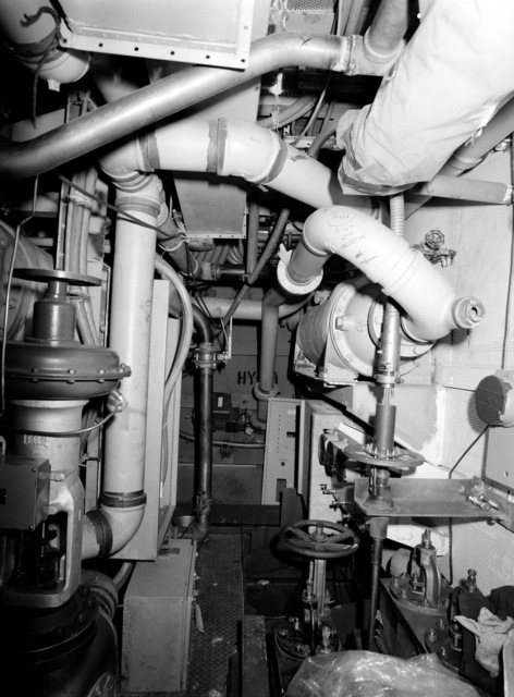 An interior view of auxiliary machine room No. 1 on the guided missile frigate USS CLARK (FFG 11) under construction