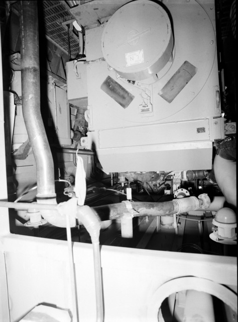 An interior view of auxiliary machine room No. 2 on the guided missile frigate USS CLARK (FFG 11) under construction