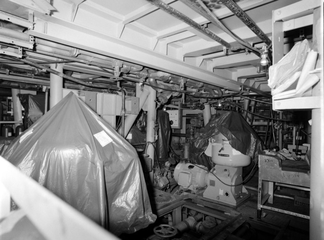 An interior view of auxiliary machine room No. 2 on the guided missile frigate USS ESTOCIN (FFG 15) under construction