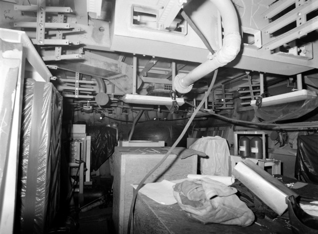 An interior view of auxiliary machine room No. 3 on the guided missile frigate USS ESTOCIN (FFG 15) under construction