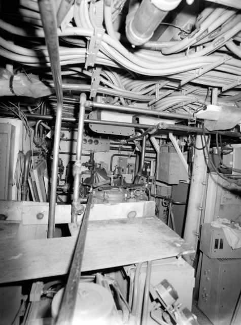 An interior view of auxiliary machine room No. 3 on the guided missile frigate USS CLARK (FFG 11) under construction