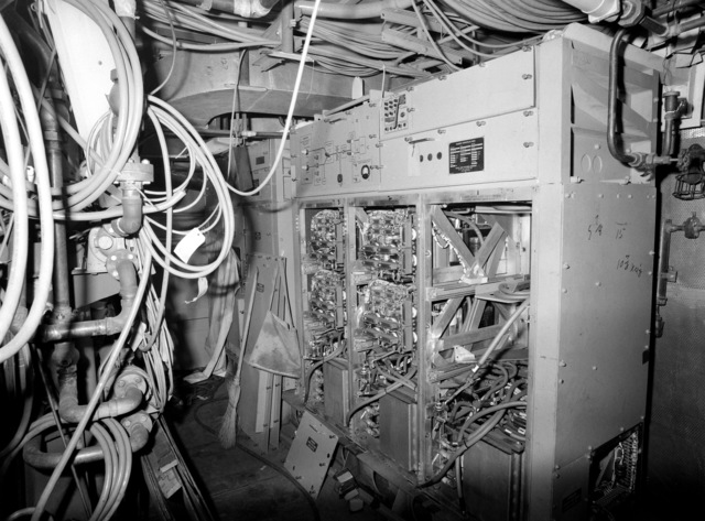 An interior view of the air conditioning machine room on the guided missile frigate USS CLARK (FFG 11) under construction