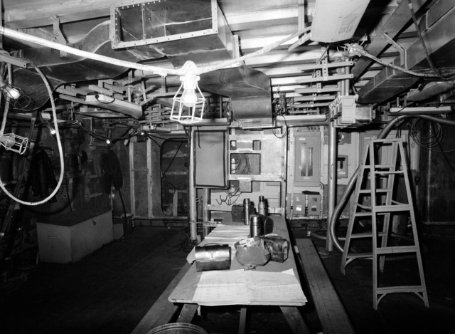 An interior view of the combat information center equipment room on the guided missile frigate USS ESTOCIN (FFG 15) under construction