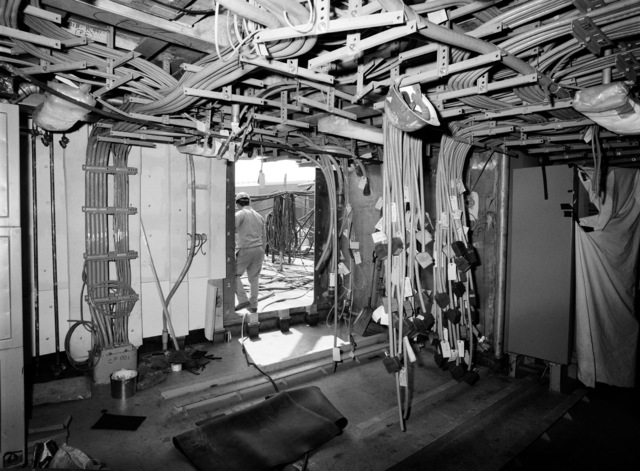 An interior view of the combat information center equipment room on the guided missile frigate USS CLARK (FFG 11) under construction
