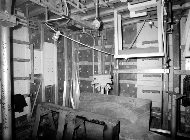 An interior view of the combat information center on the guided missile frigate USS ESTOCIN (FFG 15) under construction