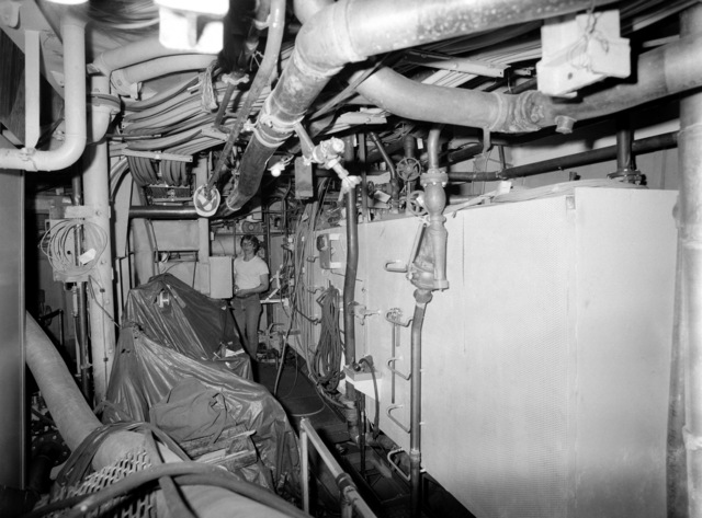 An interior view of the engine room on the guided missile frigate USS CLARK (FFG 11) under construction