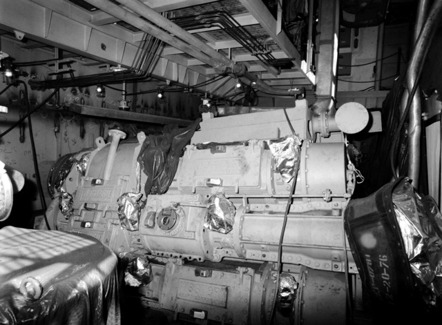 An interior view of the engine room on the guided missile frigate USS ESTOCIN (FFG 15) under construction