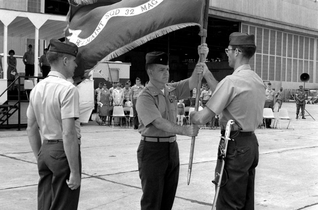 MAJ Thomas C. McClay receives the Headquarters and Maintenance Squadron 32 Colors as he relieves LTC Frederick F. Harshbarger of command