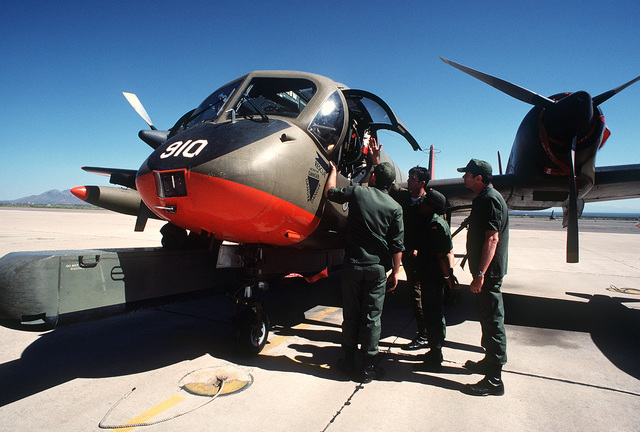 A left front view of an OV-1D Mohawk aircraft equipped with an APS-94 side-looking airborne radar pod under the fuselage