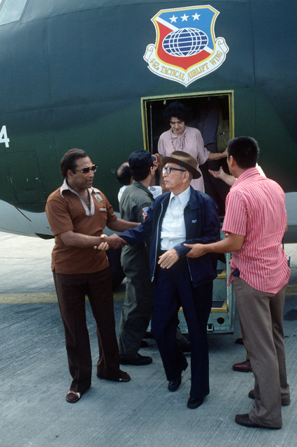 US citizens and foreign nationals are assisted off a US Air Force Reserve C-130E Hercules aircraft at Tocumen International Airport after being evacuated from war-torn Nicaragua. The aircraft is assigned to the 442nd Tactical Airlift Wing