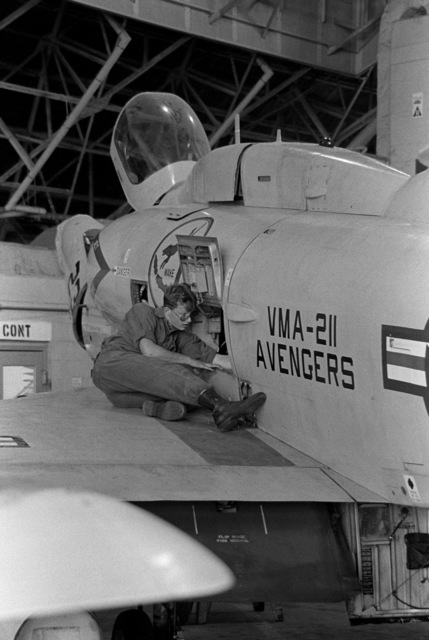 LCPL Peter C. Fisher of Marine All-Weather Attack Squadron 211 (VMA-211) makes repairs to a Marine A-4M Skyhawk aircraft