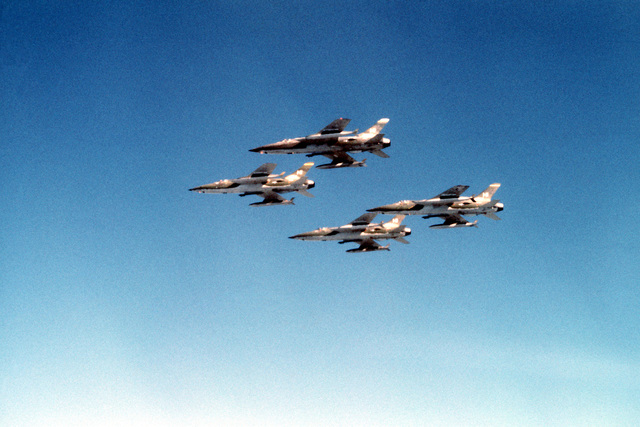 An air-to-air view of four F-105 Thunderchief aircraft from Hill Air Force Base, Utah, in diamond formation during Air Force Reserve Operation REDOUBT, PHASE III