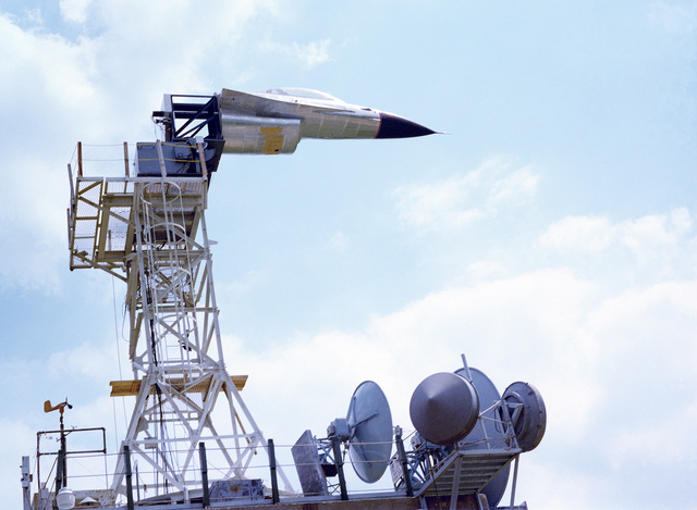 Prior to the arrival of a full F-16 Fighting Falcon aircraft, an F-16 nose section is mounted on a testing tower at the Rome Air Development Center Newport Site, Tanner Hill. At this facility portions of an aircraft can be tested to determine what effect they have on transmitting and receiving electromagnetic signals
