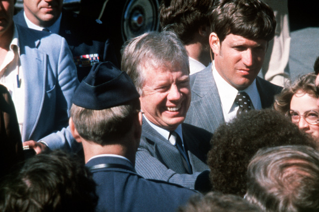 President Jimmy Carter is greeted by military personnel and their families upon his arrival for a visit