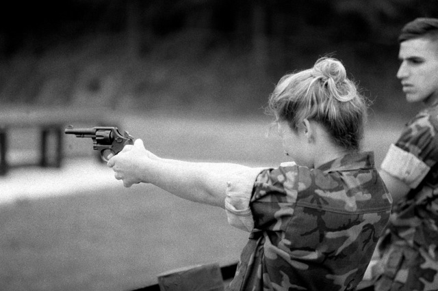 Lance CPL. Jennifer L. Hague fires a .38-caliber service revolver as part of her training at the Marine Security Guard School, Marine Corps Development and Education Command. Each Marine must qualify with the revolver before assignment to an American embassy in a foreign country