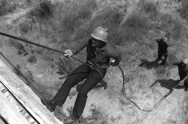 Midshipmen participate in a rope rappelling class at the Infantry Training School, while on their college spring break and tour of Camp Pendleton