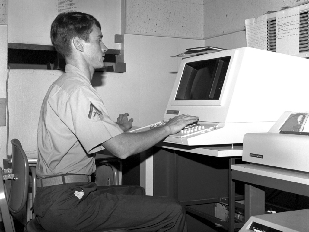 LCPL H. D. Sulger of the base communications center is processing a message on a Univac optical character reader so that the message can be transmitted to another military base