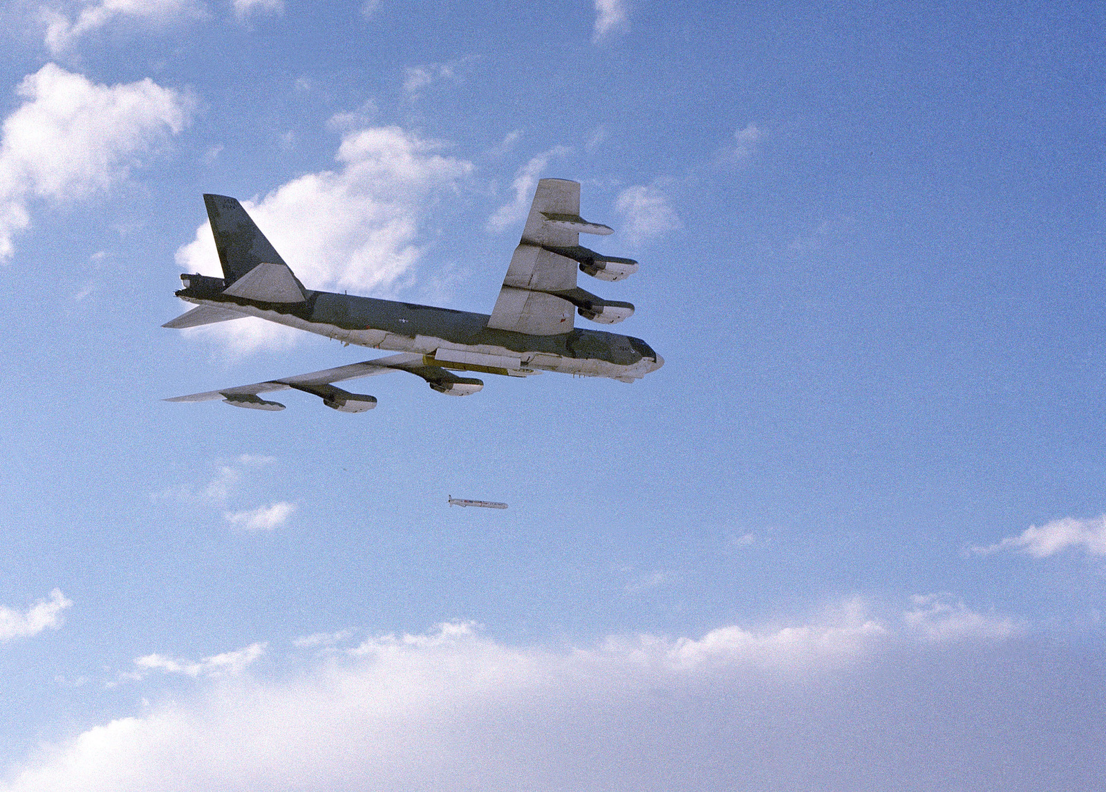 A B-52 Stratofortress aircraft drops an AGM-109 Tomahawk air-launched cruise missile while in flight