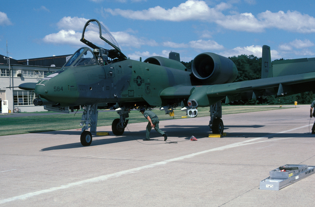 A ground crewman services a Connecticut Air National Guard A-10A Thunderbolt II aircraft on the flight line at Bradley Field