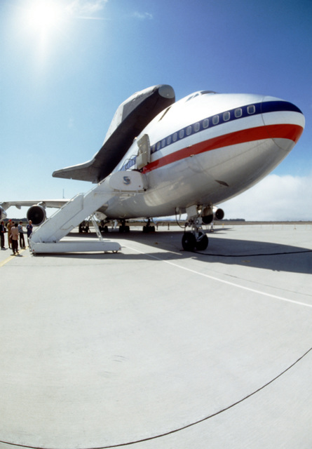 A ground view of the space shuttle, Columbia, as it sits atop the mother ship, a 747 aircraft (May 1980 PHOTO Contest entry)