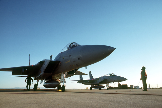 A right front view of two parked F-15 Eagle aircraft in early morning. The aircraft is involved in Tactical Training Luke and is assigned to the 550th Tactical Fighter Training Squadron, 405th Tactical Training Wing, 12th Air Force