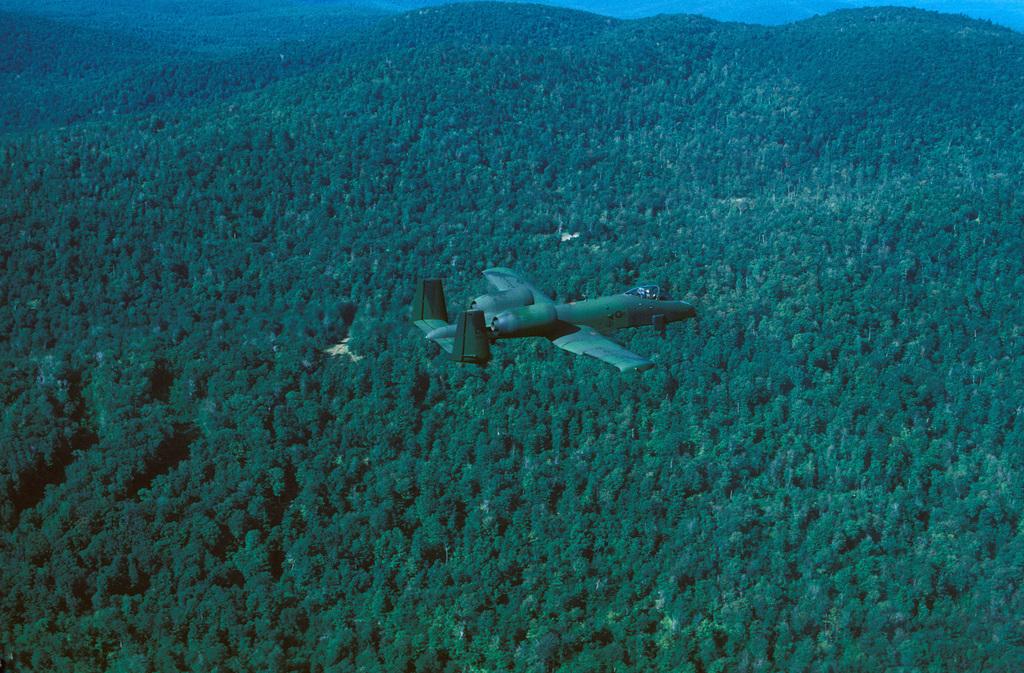 An air-to-air right side view of a Connecticut Air National Guard A-10A Thunderbolt II aircraft
