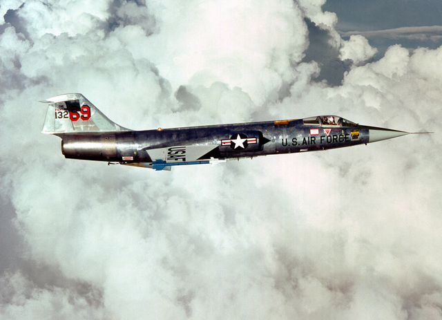 AN air-to-air right side view of an F-104 Starfighter aircraft carrying two AIM-9J Sidewinder missiles. The aircraft, from the 69th Tactical Fighter Training Squadron, 58th Tactical Training Wing, 12th Air Force, is involved in Tactical Training Luke