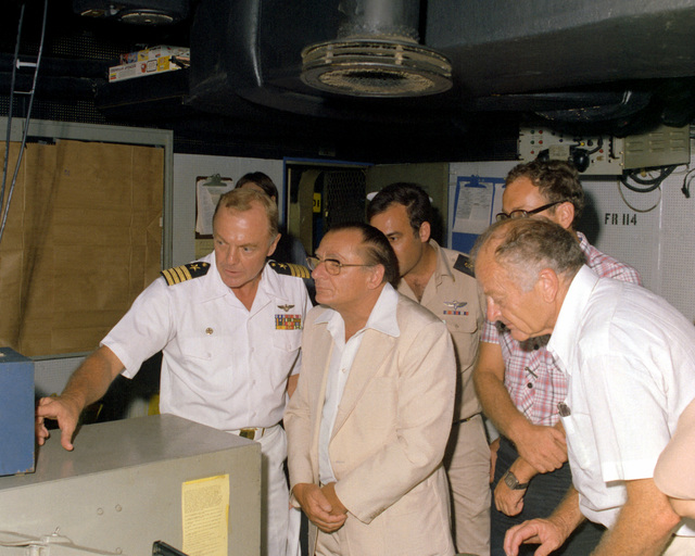 CAPT Thomas C. Watson Jr., left, give distinguished guests a tour of the combat information center (CIC) aboard the aircraft carrier USS INDEPENDENCE (CV-62)