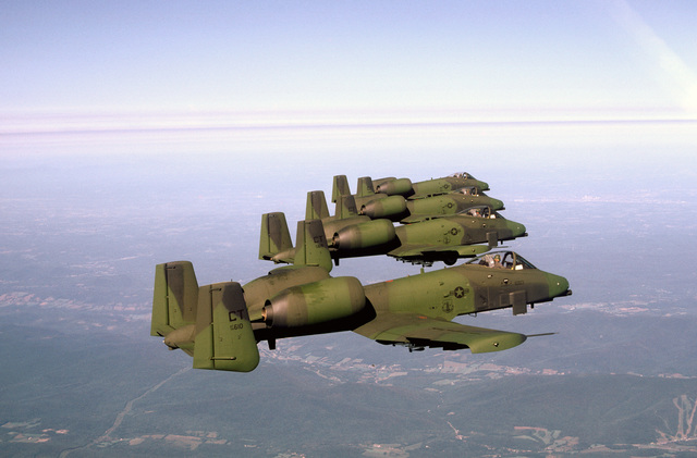 Four Connecticut Air National Guard A-10A Thunderbolt II aircraft fly in formation