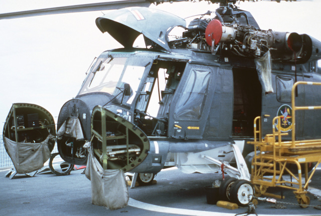 Front left view of an HH-2D Seasprite helicopter from Light Helicopter Antisubmarine Squadron 31 (HSL-31), Detachment B, receiving a phase inspection aboard the Chavenet class surveying ship USNS CHAUVENET (T-AGS 29)