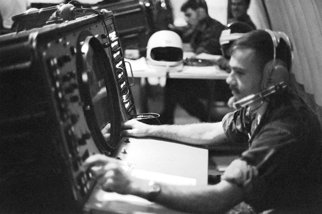 SSGT Davis of the Tactical Air Command Center is in radio contact with an aircraft