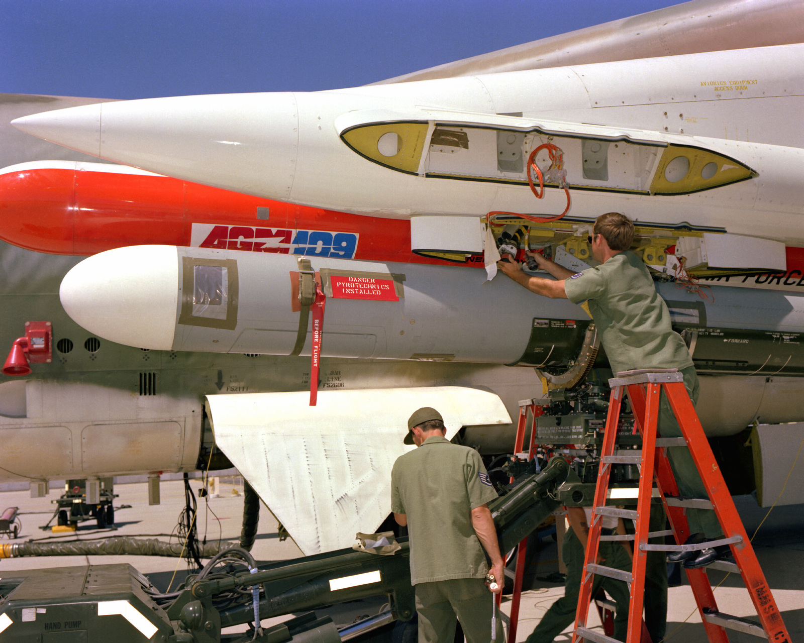 A ground crew loads AGM-109 Tomahawk air-launched cruise missiles on a B-52 Stratofortress aircraft