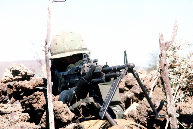 LCPL Edward D. Ford of Co. A, 1ST Bn., 12th Marines, 3rd Mar. Div., Fleet Marine Force, guards part of the perimeter with an M-60 machine gun during the battalion's combat readiness evaluation at the Pakalula Training Area