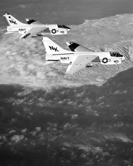 An air-to-air right side view of two Attack Squadron 27 (VA-27) A-7E Corsair II aircraft over the southern California coast