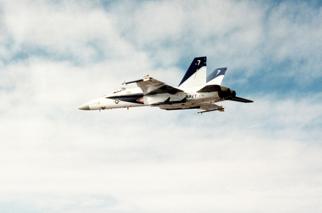 A left underside view of an F/A-18 Hornet aircraft armed with AIM-9 Sidewinder missiles (wingtips) and AIM-7 Sparrow missiles (inboard) during a test flight