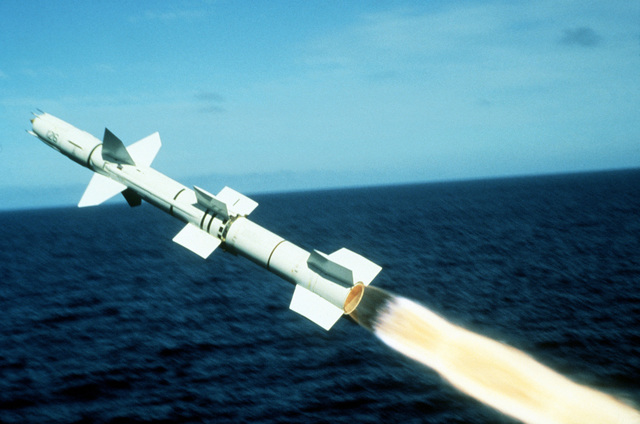 A view of a Talos surface-to-air guided missile, moments after being launched from the starboard side of the guided missile cruiser USS OKLAHOMA CITY (CG 5) at the Pacific Missile Test Range. This is the final firing of the Talos missile by the United States Navy. (Second view in a series of five)