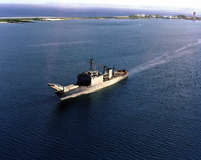 An aerial port bow view of the tank landing ship USS TUSCALOOSA (LST 1187) underway